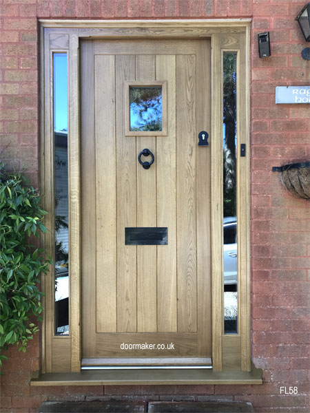 ak cottage door with sidelights